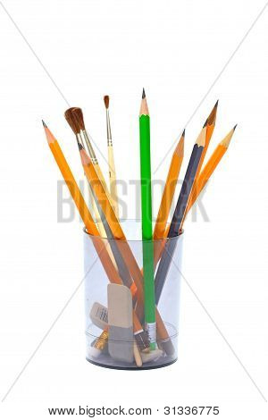 pencils and brushes in a gray cup