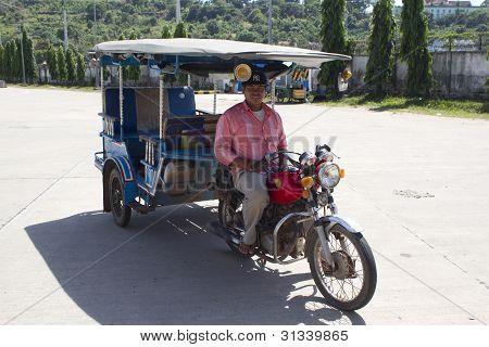 Tuk Tuk Taxy And Driver In Cambodia