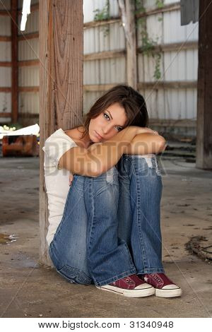 Beautiful Brunette Sitting In An Abandoned Warehouse (4)