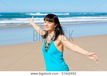 Young Woman Enjoys Her Time On The Beach