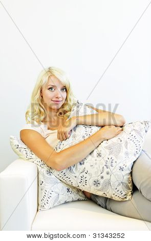 Smiling Woman With Cushions On Couch