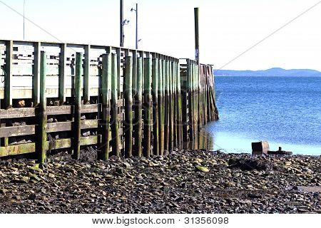 Local Fishing Pier At Low Tide