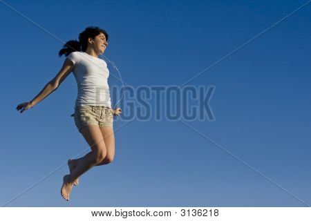 Teen Girl Soaring In The Air