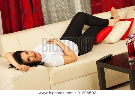 Beauty Woman Lying On Couch