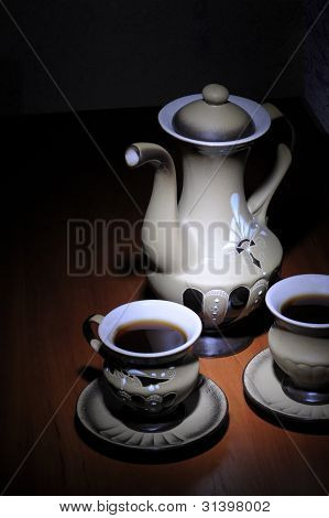 Coffeepot And Two Coffeecups In Dark