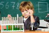 Boy Test Tubes Liquids Chemistry. Chemical Analysis. Talented Scientist. Kid Study Chemistry. Biotec poster