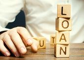 Wooden Blocks With The Word Loan And Businessman. Consumer, Banking And Property Loan. Business And  poster