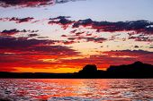 Calming Silhouette Sunset Of Lone Rock In Wahweap Bay Of Lake Powell In Arizona.   The Sky Has Scatt poster