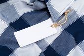 Rectangular Tag On A Clothes. Fashion, People And Shopping Concept - Close Up Price Tag Of Clothing  poster
