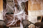 Spooky Spider Web On Building Facade In City Street, Holiday Decoration Of Store Fronts. Halloween S poster