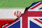 England And Iran Flag Print Screen On Cracked Wall.iran Arrest Oil Ship Of England At Strait Of Horm poster