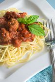 stock photo of italian food  - plate of spaghetti with italian meatballs and basil - JPG