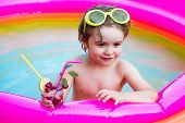 Child Having Fun In Summertime. Happy Child Having Fun At Swimming Pool On Sunny Day. Little Girl Ha poster