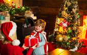 Santa Claus Coming. Mother And Little Child Boy Adorable Friendly Family Having Fun. Family Having F poster