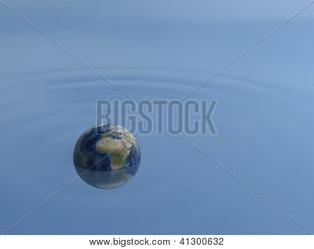 world drifting in water