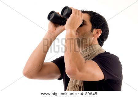 Man Looking Through Binocular