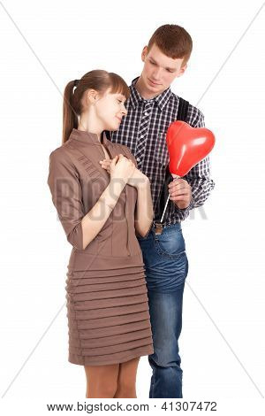 Happy couple with heart shape balloon