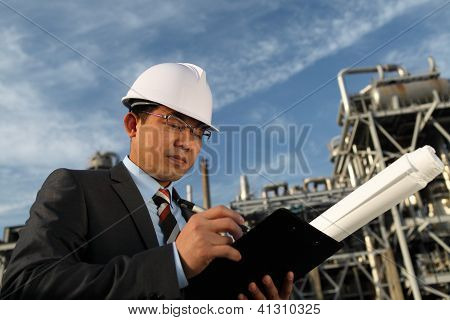 Businessman With Oil Refinery Background