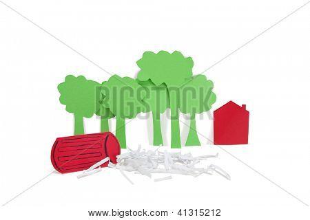 Corte de papel salidas que representa el concepto de daño ambiental sobre fondo blanco