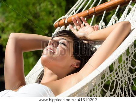 Woman Napping In Amaca Outdoors On Summer