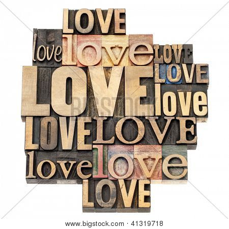 love word abstract - a collage of isolated text in vintage letterpress wood type printing blocks, a variety of fonts
