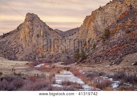 winter dusk in mountains - Eagle Nest Rock and North For of Cache la Poudre River in northern Colorado near Fort Collins