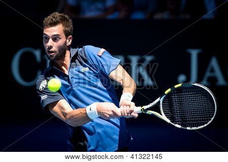MELBOURNE - JANUARY 15: Benoit Paire of France in his first round loss to Roger federer of Switzerland at the 2013 Australian Open on January 15, 2013 in Melbourne, Australia.