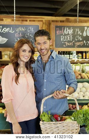 Portrait of a happy young couple in supermarket