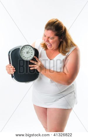 obese woman looking pissed or angry at scale