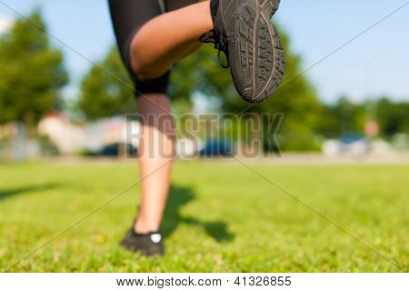 sports - young woman jogging for fitness on a beautiful summer day