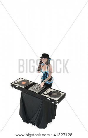 Young DJ with sound mixing equipment wearing hat over white background