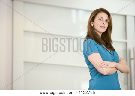 Businesswoman Standing Indoors