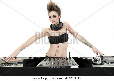 Beautiful young female DJ wearing strapless lingerie over white background