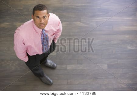 Businessman Standing Indoors