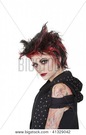 Portrait of punk woman showing attitude over white background