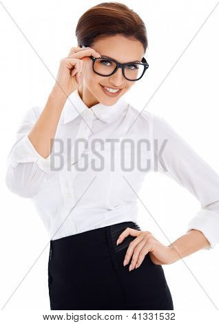 Smiling brown-haired woman with black framed nerd glasses and white shirt, posing