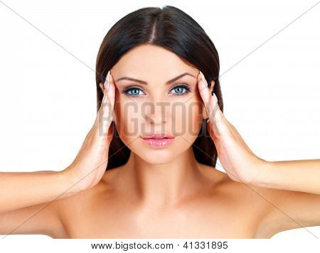 Head and shoulders beauty portrait of a naked beautiful woman massaging her temples with her fingertips isolated on white