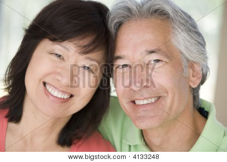 Couples Relaxing Indoors And Smiling