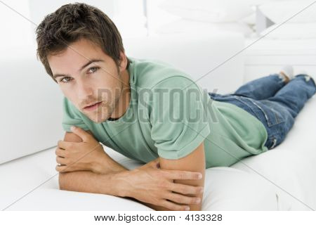Man Lying In Living Room