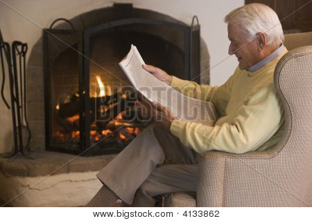 Man In Living Room Reading Newspaper