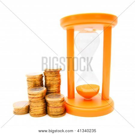Gold coins and sand-glass. On a white background.