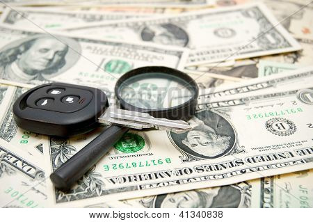 Keys from the car and a magnifier on money.