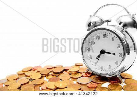 Alarm clocks and gold coins.