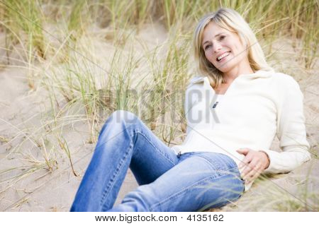 Woman Lying On Beach Smiling
