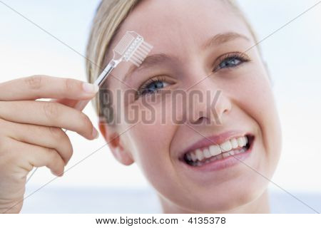 Woman With Eyebrow Brush Smiling