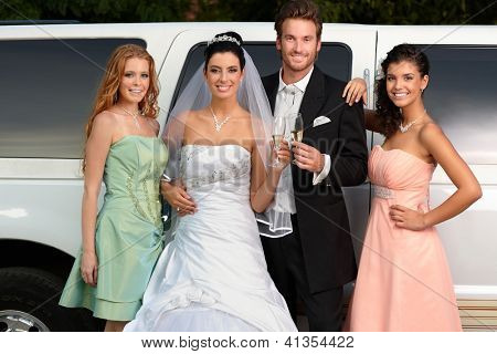 Young couple with bridesmaids on wedding-day.