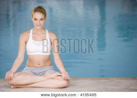 Woman Sitting Poolside Doing Smiling