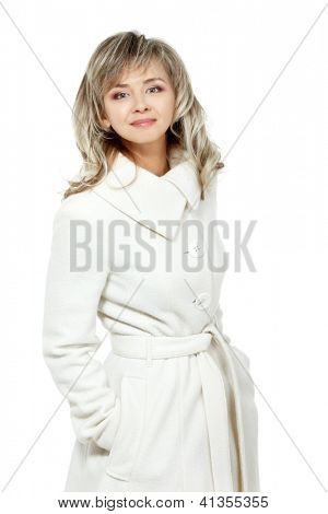 seasonal portrait of cheerful mid adult woman, attractive caucasian 40 years old woman in coat over white