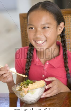 Young Girl In Dining Room Eating Chinese Food Smiling