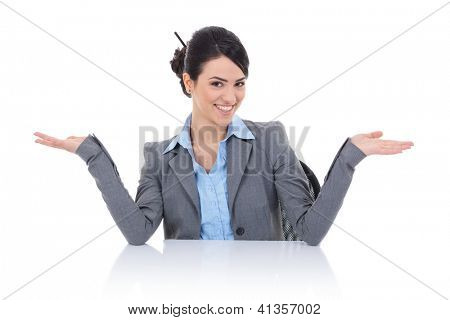young business woman sitting behind desk and welcomming you with a beautiful smile on her face and arms wide open. isolated on white